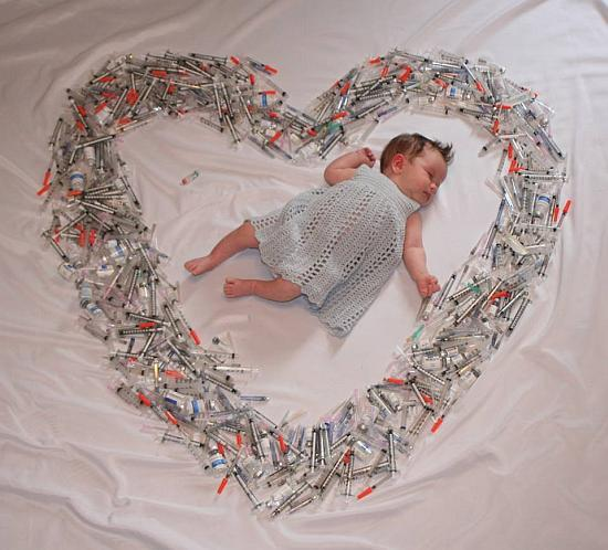 Baby Surrounded by Syringes